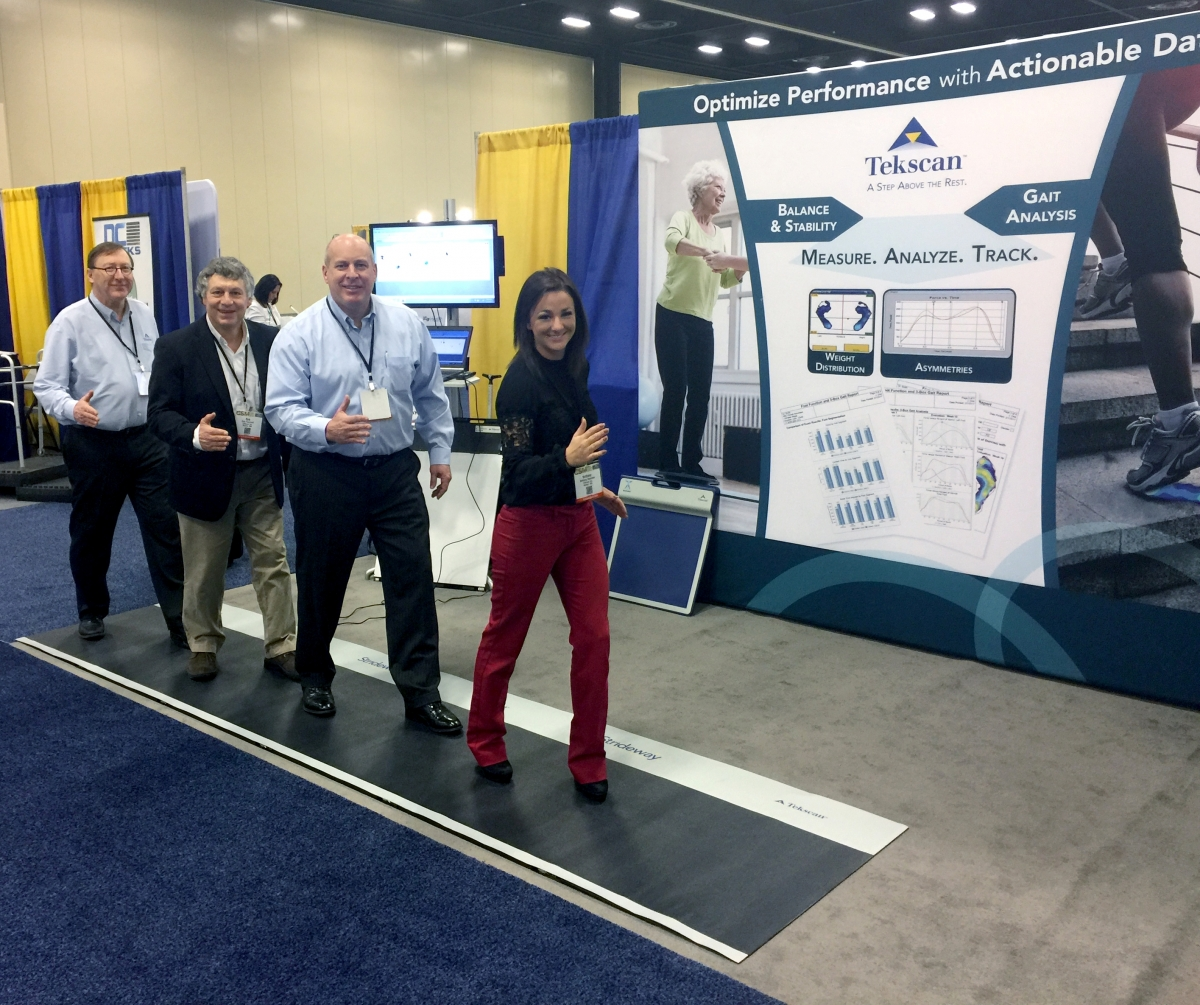 The Tekscan Team posing for a picture on the Strideway at APTA.