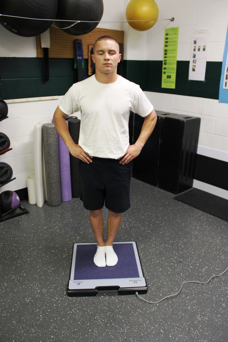 Performing one of the stances of the BESS test on the MobileMat.