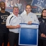 Norman Murphy of Tekscan with the Sports Program Director at Cégep de Thetford and two football players holding the MobileMat.